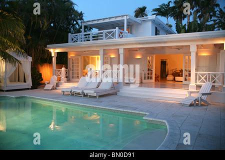 Back Yard of House with Pool at Dusk, Miami, Florida, USA - Stock Photo