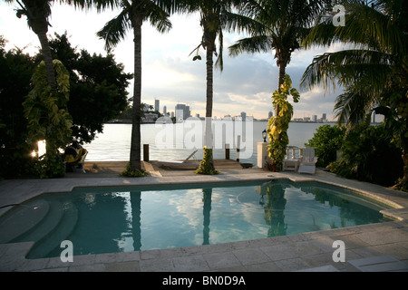 View From House Over Pool on The Skyline of Miami at Dusk - Stock Photo