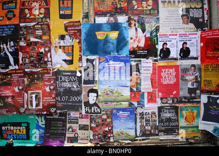 ISTANBUL, TURKEY. Posters and bills advertising local events on a wall on Sofyali Sokagi in Beyoglu district. 2009. - Stock Photo