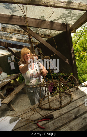 A woman making a willow sculpture on a creative art day class at The Centre for Alternative Technology, Machynlleth, - Stock Photo