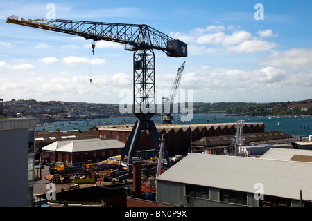 Large ships in dry dock at Falmouth shipyard for repairs an re building in Falmouth, Cornwall, England - Stock Photo