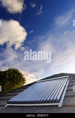 Solar Power. Solar vacuum/evacuated tubes on a domestic house roof in the UK - Stock Photo