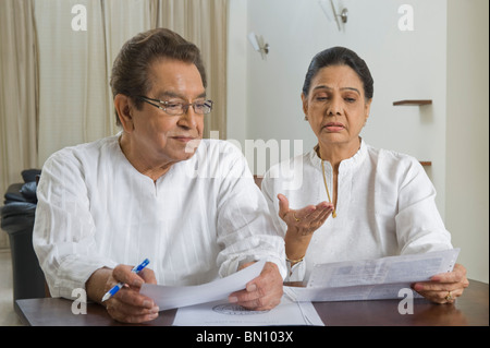Couple sorting out bills - Stock Photo