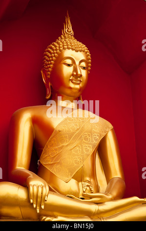 Golden Buddha statue at Wat Bupparam Buddhist temple in Chiang Mai, Thailand. - Stock Photo