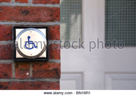 Close up image of a wheelchair access door opener outside a building in England, UK - Stock Photo