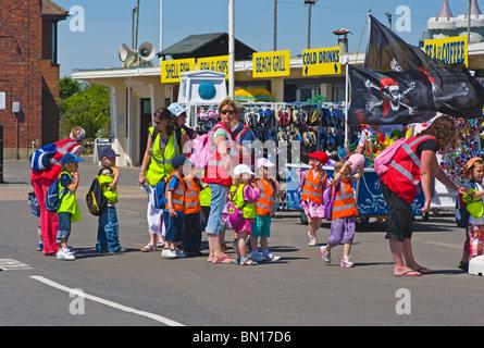 Schoolchildren On A Day Trip To Littlehampton West Sussex England - Stock Photo