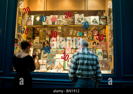 Paris, France, People Looking in Shop Front Window of Gay Bookstore, 'Mots à la Bouche' in the Marais District, - Stock Photo