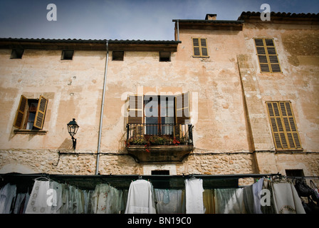 A street market stall below a traditional rustic town house in Sineu, Mallorca - Stock Photo