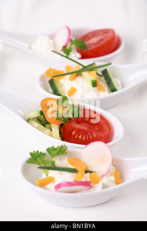 Fingerfood served in small spoons - Stock Photo