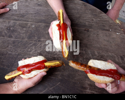 Three traditional bratwurst sausages in Berlin Germany - Stock Photo