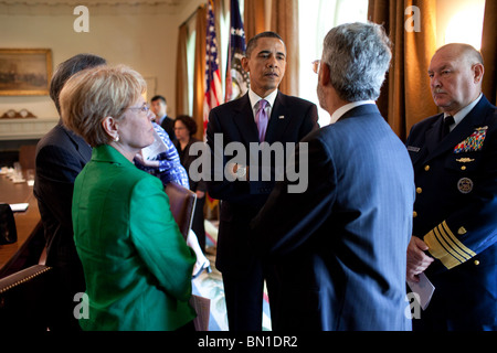 President  Obama talks with cabinet members - Stock Photo