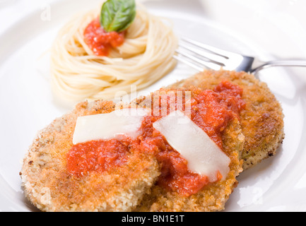 Vegan Eggplant Parmesan with Angel Hair Pasta and Marinara Sauce - Stock Photo