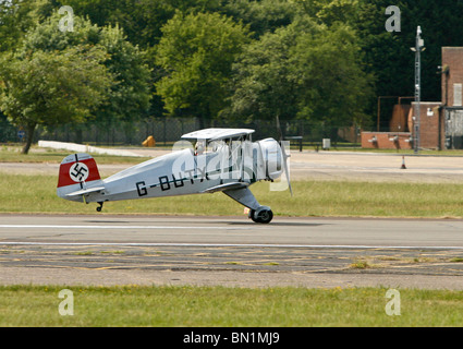 Bucker BU-133C Jungmeister aircraft preparing to take off at Biggin HIll in Kent England - Stock Photo