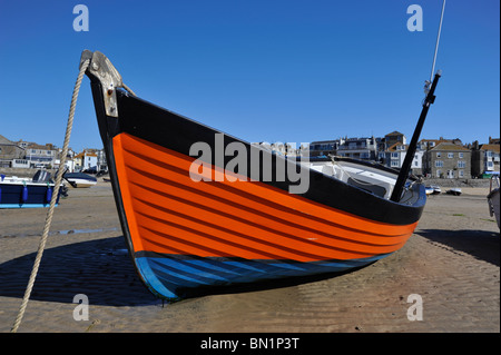 Colorful Fishing Boat on the harbor beach at St Ives, Cornwall - Stock Photo