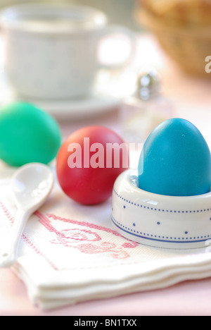 Dyed Easter Eggs in an Egg Cup on a Nicely Decorated Breakfast Table - Stock Photo