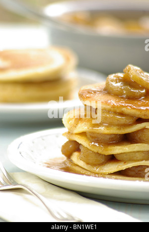 Stack of Pancakes stuffed with Banana Slices - Stock Photo