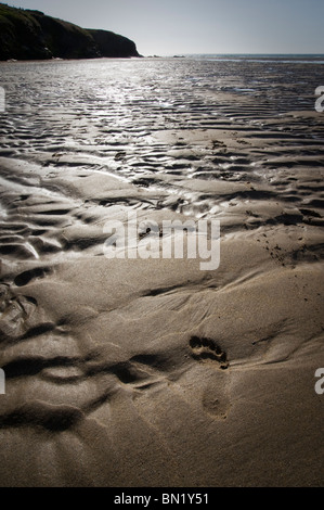 High contrast picture of patterns and footprint in the sand at Porthcothan Beach, St Merryn, Cornwall, UK - Stock Photo