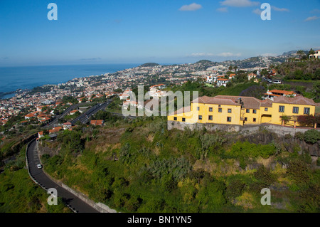 Portugal, Madeira Island, Funchal. Cable car ride from Funchal to Monte. Roof top View from cable car. - Stock Photo
