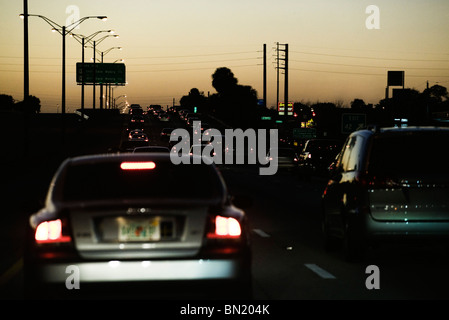 Traffic on highway at dusk - Stock Photo