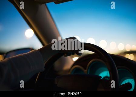 Driving at twilight - Stock Photo