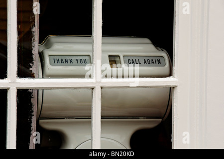 Scales in an abandoned shop window - Stock Photo