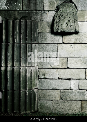 Old stone wall with architectural details artistic background - Stock Photo