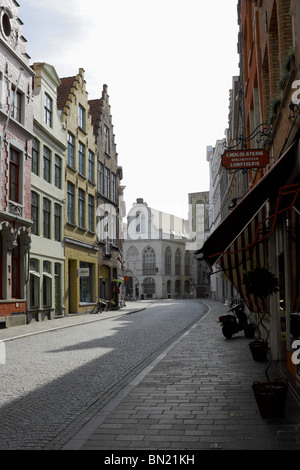 Gabled roofs and shops along Acadamiestraat, Bruges, Belgium - Stock Photo