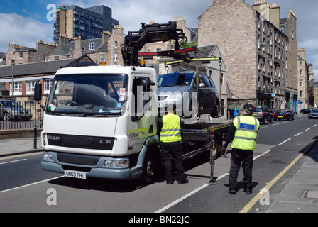 Staff from Edinburgh City Council impound an illegally parked car. - Stock Photo