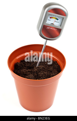 Ph meter soil tester 5 inch plastic pot with compost - Stock Photo