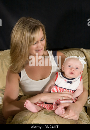 A mother with her two month old baby - Stock Photo