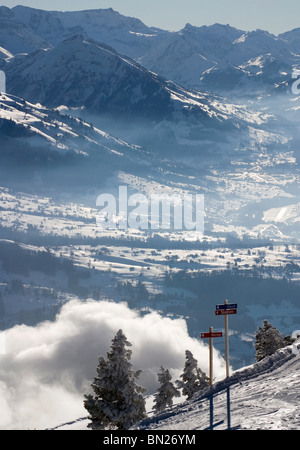 Swiss Alps ski resort at niederhorn nearby Beatenberg: Ski slopes and sledge slopes and view on the Alps - Stock Photo