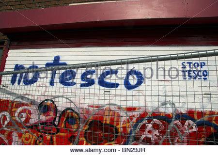 Anti Tesco development graffiti in Stokes Croft, Bristol, UK. - Stock Photo