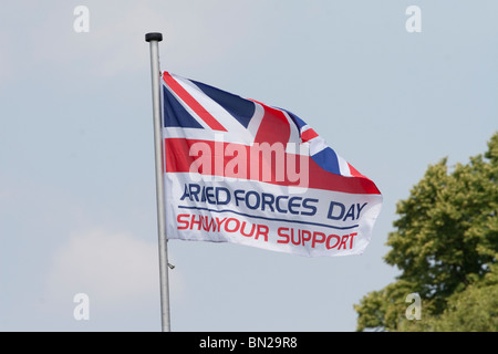 A UK Armed Forces Day flag asking for your support - Stock Photo
