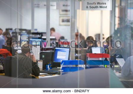 Sales people working in call center office - Stock Photo