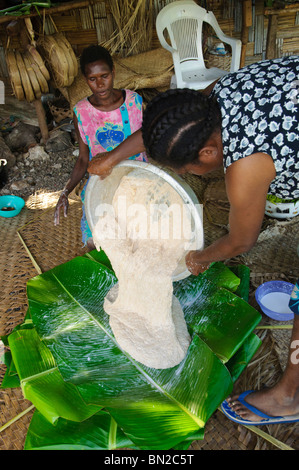 Traditional food preparation by south Pacific islanders. Pls click for more info. - Stock Photo