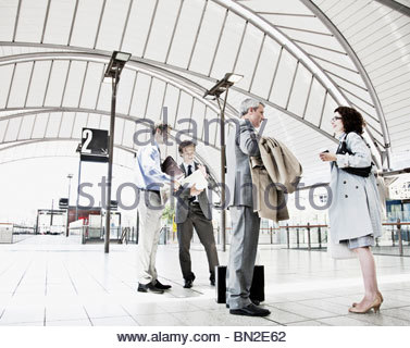 Business people waiting in train station - Stock Photo
