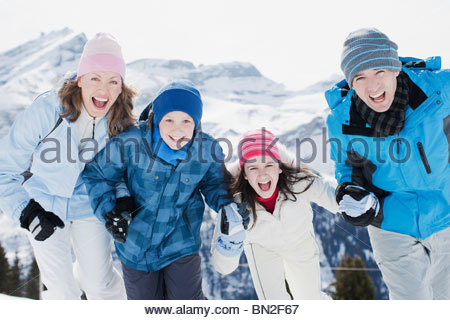 Family standing outdoors in snow - Stock Photo