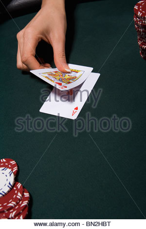 Woman playing blackjack in casino - Stock Photo