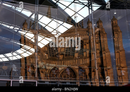 St Peter Mancroft church reflected in the glass wall of The Forum in Norwich Norfolk, UK