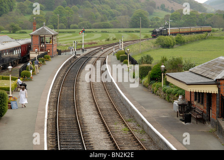 Steam train of Llangollen Railway approaching Carrog Station, Wales, UK - Stock Photo