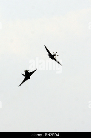 Royal Air Force Typhoon flies with a Spitfire - Stock Photo