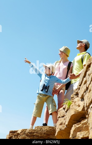 Portrait of family members looking afar while standing on cliff - Stock Photo