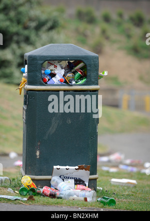 A bin over flowing with rubbish in Seaford, East Sussex, UK. - Stock Photo