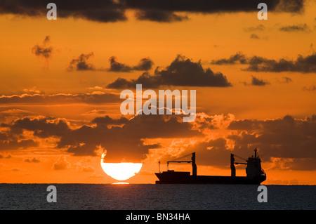 Sunrises over ship anchored off Miami Beach, Florida, USA - Stock Photo
