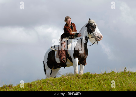 young woman riding Irish Tinker - Stock Photo