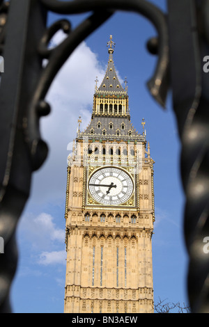 Big Ben seen through the security fence railings at the Houses of Parliament, London, England - Stock Photo