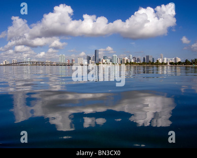 Downtown skyline with clouds reflect in calm Biscayne Bay off Virginia Key, Miami, Florida, USA - Stock Photo