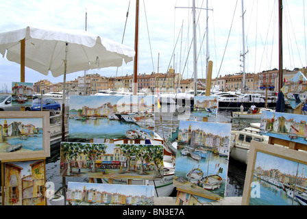 Display of paintings at the harbour of St. Tropez, France - Stock Photo