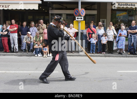 Man with alp horn in traditional swiss costume and Bernese Mountain dogs walking in parade in Interlaken , Swiss - Stock Photo