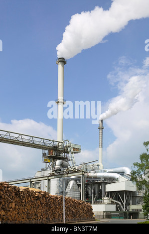 Low angle view of smoke emitting from chimneys - Stock Photo